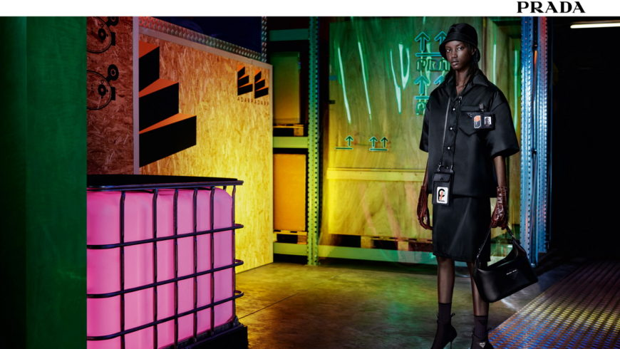 Models posing dreamlike in an industrial landscape for the new Prada campaign
